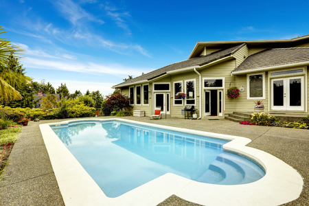 outside of house: Backyard with swimming pool. Real estate in Federal Way, WA