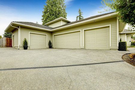 one story: One story house with three car garage and driveway