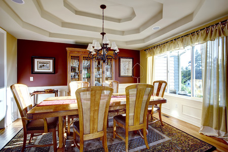 Dining Room With Coffered Ceiling, Burgundy And Yellow Walls And Hardwood  Floor. Wooden Cabinet