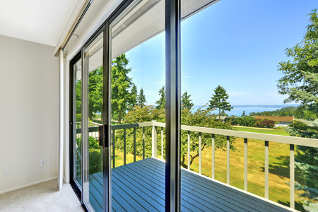 slide glass: House with water view. Walkout deck with glass slide door Stock Photo