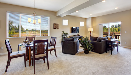open floor plan: Modern apartment interior with open floor plan. DIning area and living room with walkout deck