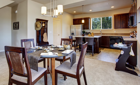 Modern apartment interior with open floor plan. DIning area and kitchen room photo