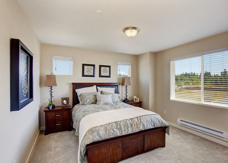 nightstands: Bright ivory bedroom with window. Wooden bed with two nightstands