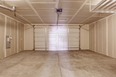 garage: Spacious empty garage interior with concrete floor
