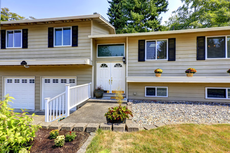 two car garage: Large two story house with two car garage . Entrance porch with railings