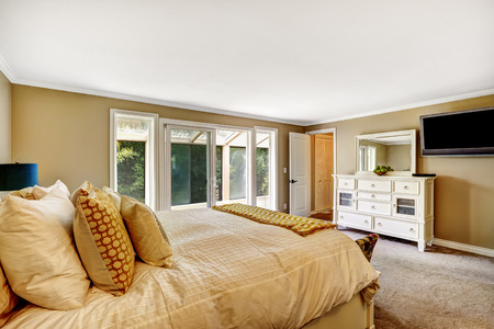 screened: Beautiful bedroom with vanity cabinet and tv. Walkout screened deck