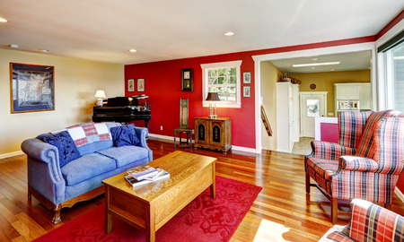furniture design: Bright contrast red room with antique furniture and hardwood floor. Real estate in Port Orchard, WA Stock Photo