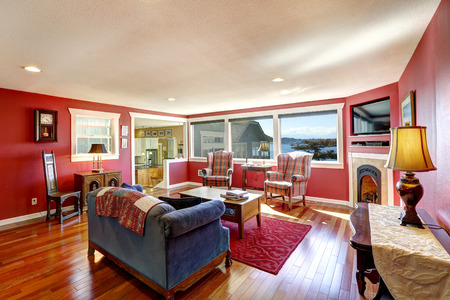 red wall: Bright contrast red room with antique furniture and hardwood floor. Real estate in Port Orchard, WA Stock Photo