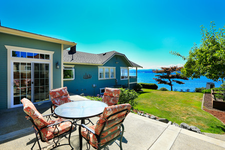 Classic house with curb appeal and water front view. View from patio area. Port Orchard town, WA