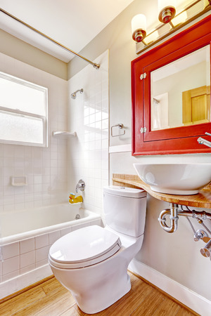 vessel sink: Refreshing bathroom interior. Red cabinet with mirror and white vessel sink