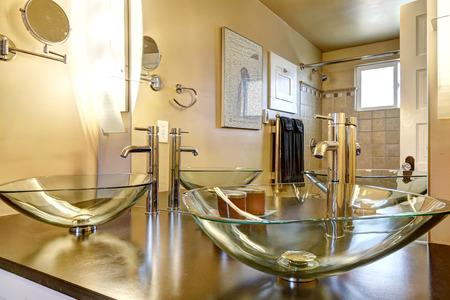 vessel sink: Bathroom vanity cabinet with glass vessel sinks and mirror