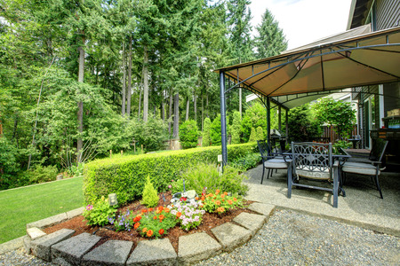 Backayrd with gazebo, patio area and  beautiful landscape design photo