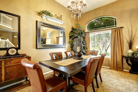 dining table and chairs: Dining room interior with wooden table and leather chairs