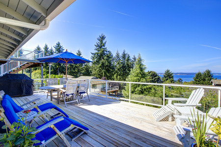 screened: Tacoma real estate. Large walkout deck overlooking bay. Screened deck with wooden floor, deck chairs and umbrella