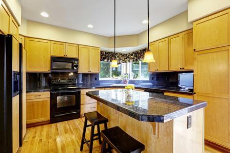 black appliances: Kitchen room with black tile backsplash trim, granite tops and black appliances