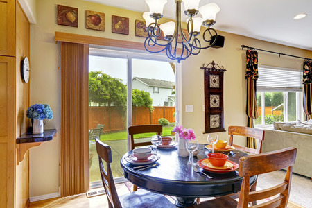 round chairs: Bright dining area in kitchen room with exit to backyard patio. Served round table with chairs