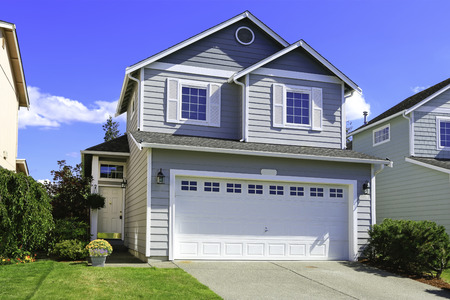 residential garage: Two story house with small entrance porch and garage with driveway