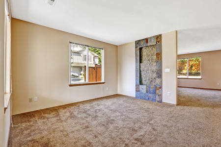 Tile wall trim in empty house with open floor plan.