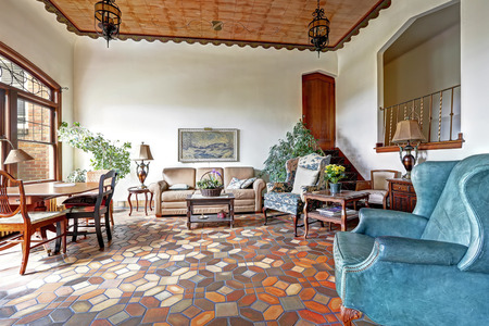 Foyer in old residential building in Downtown, Seattle. Mosaic tile floor, decorated ceiling and antique furniture merge a visitor into historic atmosphere photo
