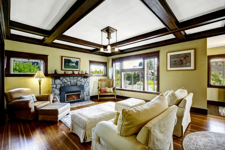 living room design: Living room design idea. Coffered ceiling blend with stone trim fireplace and rustic rocking bench