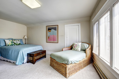 Bedroom interior with wicker sette and bed Stock Photo