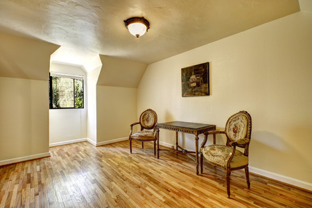 old wood floor: Empty room in old house with antique carved wood furniture, vaulted ceiling and hardwood floor