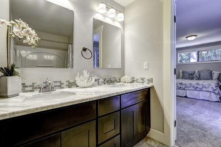 master bath: Decorated bathroom vanity cabinet with mirrors in master bedroom