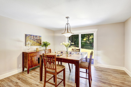 home furniture: Bright ivory dining room with walkout patio. Wooden dining table with chairs