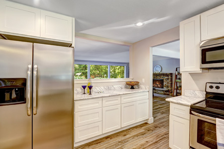cabinets: White cabinets with steel refrigerator Stock Photo