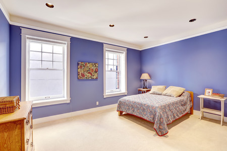 bedroom furniture: Bright purple bedroom with practical furniture