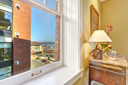 tacoma: Window with city view. Corner with antique cabinet and lamp. Tacoma  real estate, WA Stock Photo