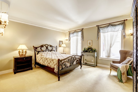 Bedroom with beautiful carved wood bed and antique chair