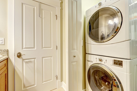 laundry room: Laundry room with modern white appliances