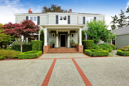 tacoma: Luxury real estate in Tacoma, WA. Entrance porch with columns and brick tirm and beautiful curb appeal