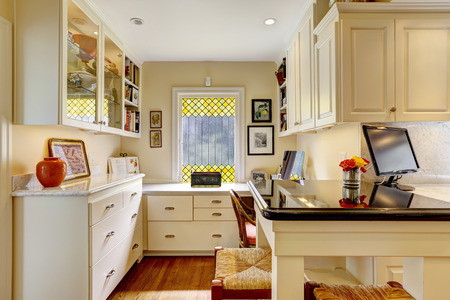 furniture design: Cozy office area with white cabinets in kitchen room