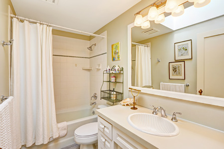 bathroom mirror: White refreshing bathroom with tile wall trim and white curtains. White bathroom cabinet with beautiful sink and large mirror