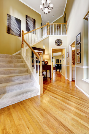 hardwood: Luxury house interior. Bright hallway with hardwood floor and staircase Stock Photo