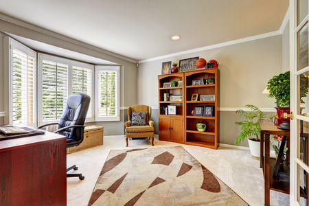office cabinet: Spacious office room with cabinet, antique armchair, desk