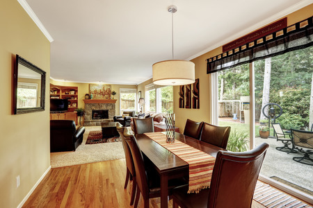 family dining: Dining area with family dining table set. Exit to backyard patio. Living room wtih fireplace