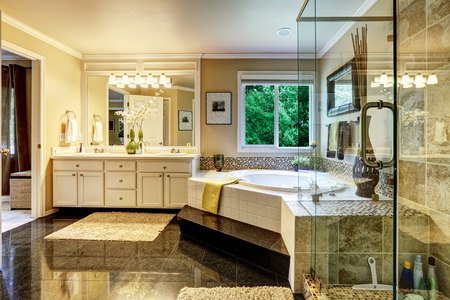 bathroom interior: Luxury bathroom interior with corner bath tub and glass transparent shower Stock Photo