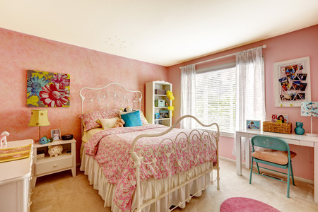 Cozy bedroom interior in pink color with white iron bed