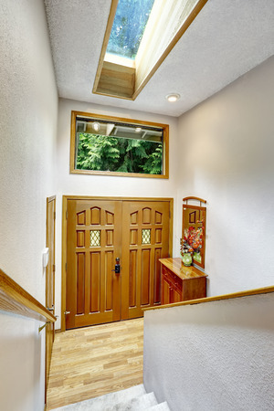 Entrance hallway with high ceiling and skylight. View from staircase photo