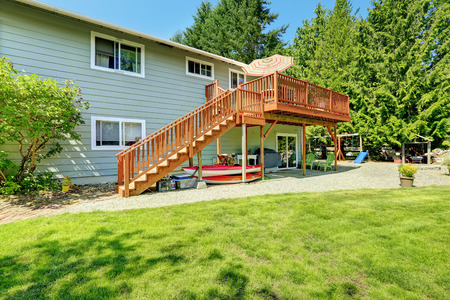 porches: Countryside house with wooden walkout deck and patio area