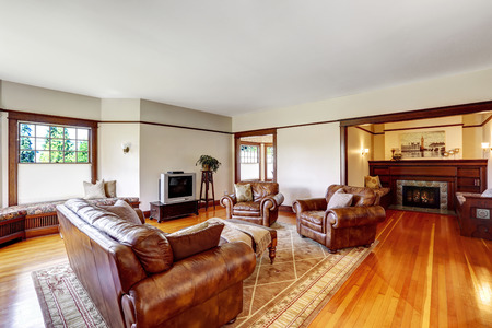 Family room with sitting area. Cozy walk-in area with fireplace and two benches. Family room with rich leather furniture set and tv