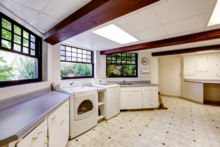 Spacious laundry area in basement photo