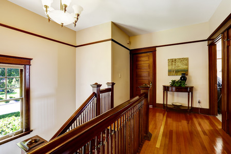 upstairs: Upstairs hallway with hardwood floor and staircase, View of balustrade
