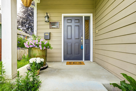 Entrance porch with concrete floor decorated with flower pots