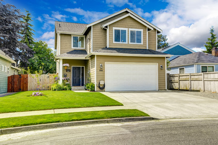 outside of house: Two story house exterior with white door garage and driveway Stock Photo