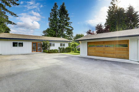 garage on house: Guest house exterior and garage with large driveway. Stock Photo