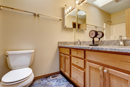 bathroom design: Bathroom cabinet with granite top decoated with antique clock Stock Photo